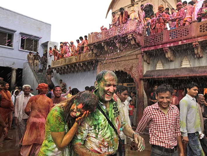 Foreign tourists are smeared in colours