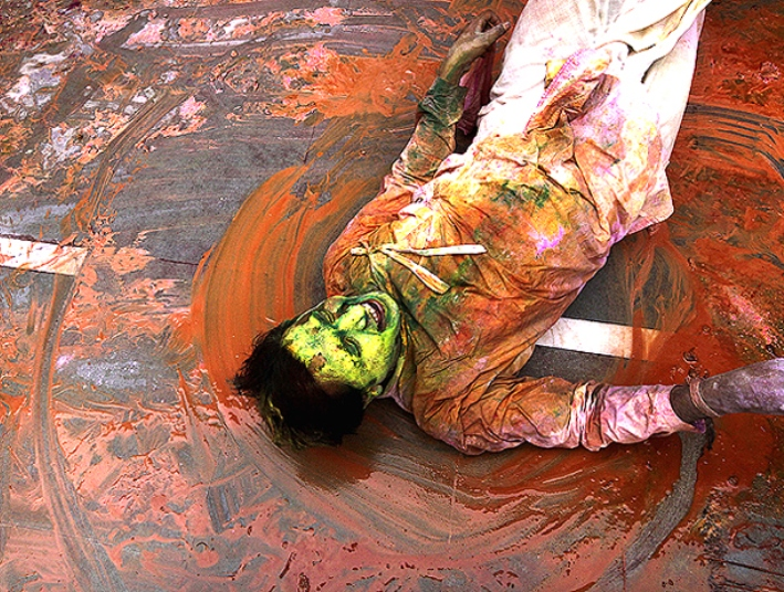 A devotee smeared with colours