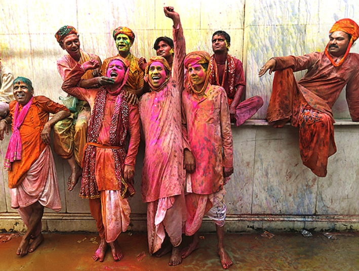 Devotees drenched in coloured water