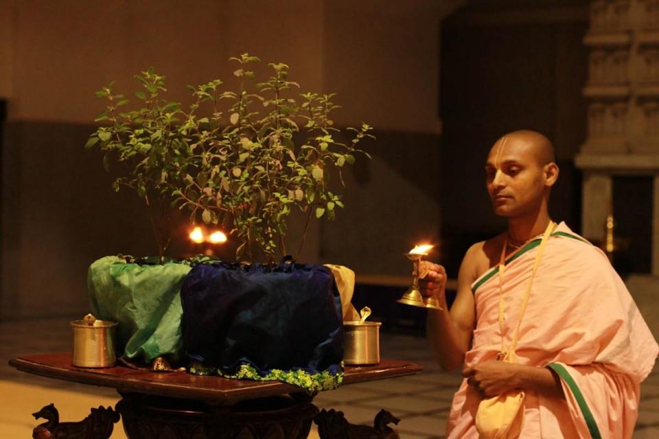 devotee performing tulasi arati