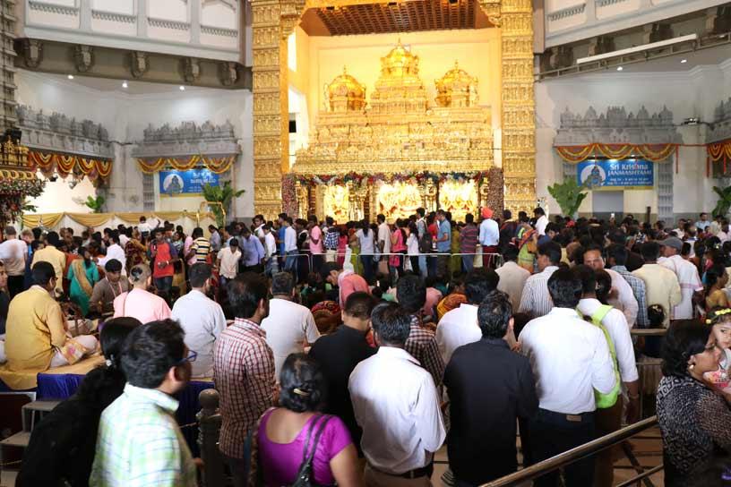 Visitors having darshan