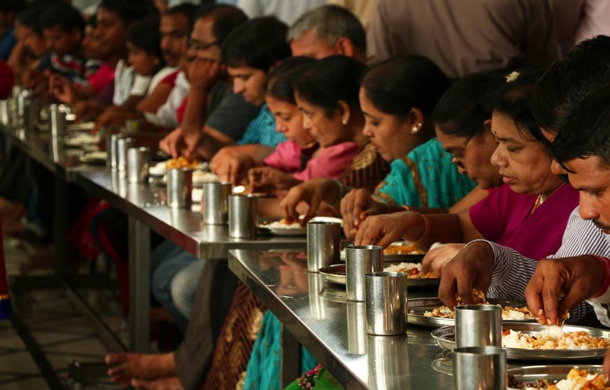 Visitors having Prasadam at Nitya Annadana Hall