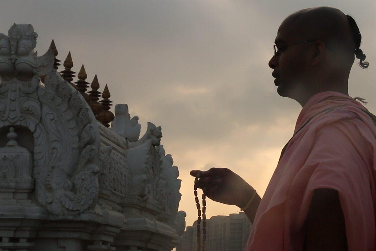 Devotee Chanting Hare Krishna Mantra
