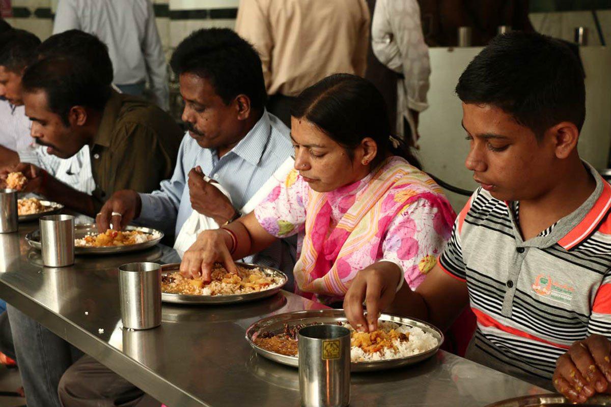 Visitors having Prasadam