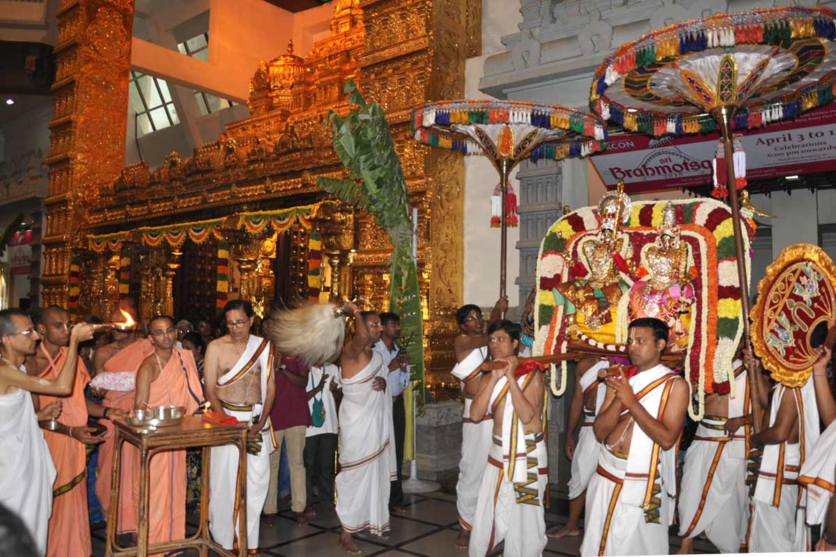Devotees carrying Their Lordships on a Pallakki
