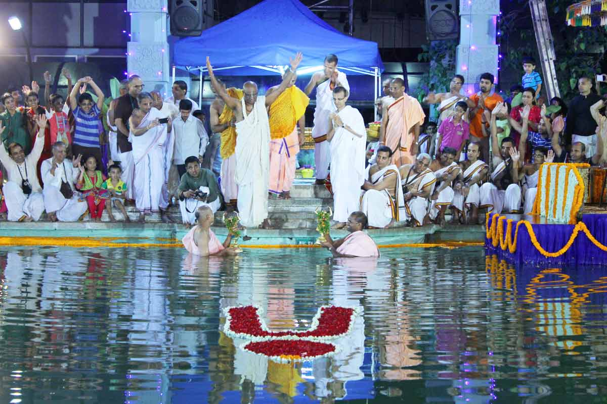 Sri Sri Nitai Gauranga taking a dip in the temple pond