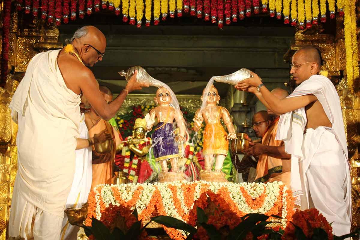 Sri Krishna and Balarama receiving Abhisheka