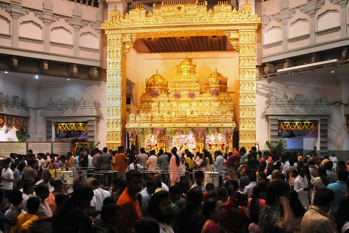 Visitors having darshan