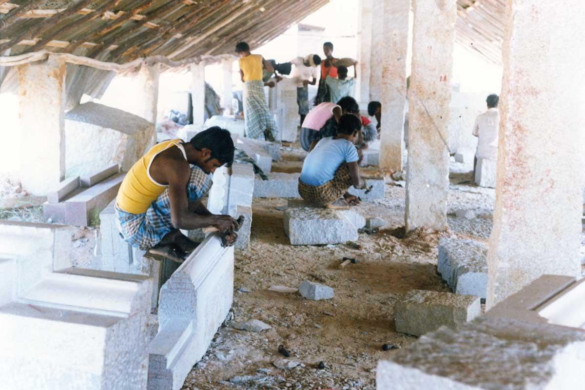 artisans working on pillars for the garbha gudi