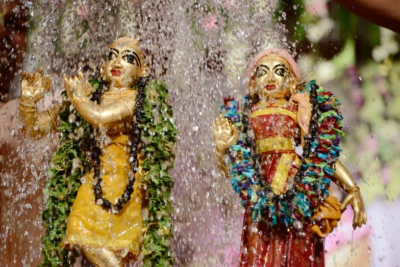 Srimati Radharani receiving abhisheka